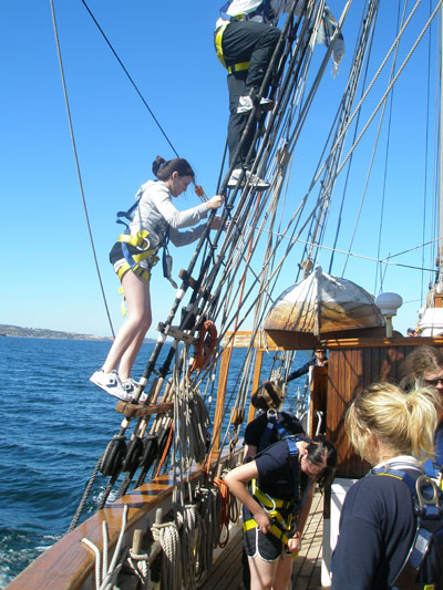 Amber Mathews climbs the rigging on the sail training vessel Windeward Bound.