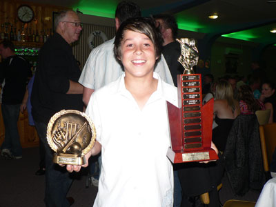 An excited Ethan Engels with the rewards of a good season with the Old Beach Cricket Club.