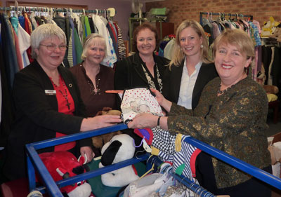 Looking over the items in the UnitingCare Op Shop are, from left, Jo Kelly (UnitingCare), Op Shop Manager Olive McVicar, Senator Carol Brown, Labor Candidate for Lyons Rebecca White and Minister Jenny Macklin.