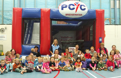 The children from the Brighton Family Day Care enjoy the new jumping castle.