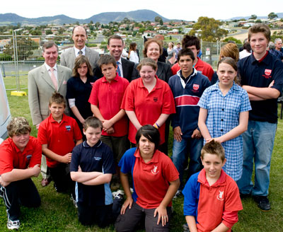 Gathered at the beginning of construction of the new gymnasium for the Bridgewater and Southern Midlands Learning Federation are Brighton mayor Tony Foster, Learning Federation manager Andy Bennett, Premier David Bartlett and Senator Carol Brown representing the Deputy Prime Minister, Julia Gillard with grades seven and eight Bridgewater High students who will be among the first to use the gym as well as students from Gagebrook and East Derwent primary schools. (In the background is the fenced-off area between Bridgewater High and Eddington Street where the new gymnasium and sport science block will be built.)