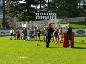 Some of the children learn footy skills at Bellerive Oval during the school holidays.