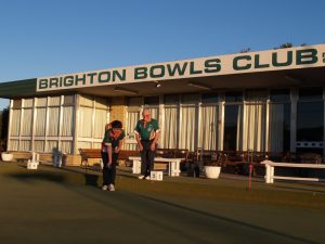 Junior representative in Southern Tasmania Bowls competition Josh Iles, left, with Club President Kevin Marshall.