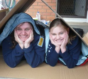 • Girl Guide Leader Fiona Hardman and her nine-year-old daughter Emily prepare to sleep out during National Homeless Persons' Week.