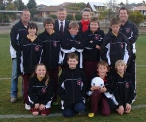 The under-12 team proudly wearing their jackets.