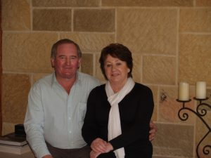 Maurice with his wife Peggy in front of their beautiful sandstone fireplace.
