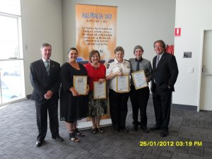 Brighton mayor Tony Foster with from left, winners of the Australia Day awards, Janelle Kava, Kerry Wilks, Kath Burns, Damian Williams